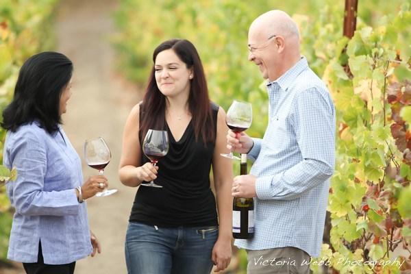 People sipping wine vineyard